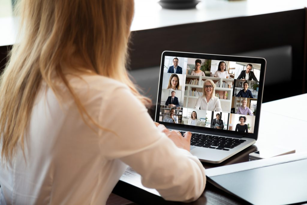 Employees communicating via video chat.